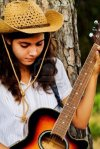 10489031-view-of-a-beautiful-young-country-girl-with-a-guitar-on-the-woods