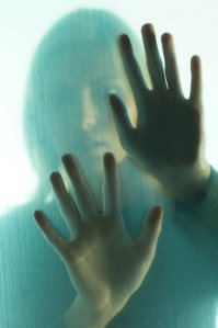 Woman touching frosted glass uid 10