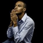 Young black male praying