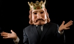 Businessman with king mask surprised
