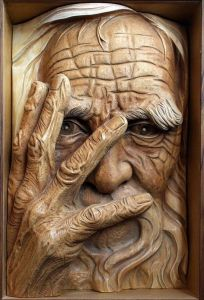 old-man-face-wood-carving